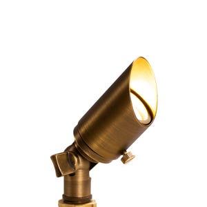 VOLT® 3W Premium 12V brass spotlight with adjustable glare guard illuminated.