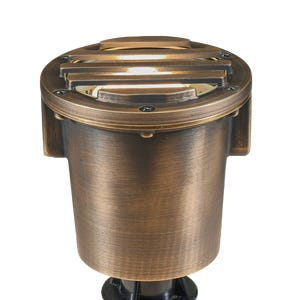VOLT® Salty Dog MR16 grated brass in-grade well light features a grated glare guard to control direct light.