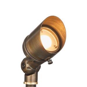 VOLT® G4 Infiniti 30 integrated LED brass spotlight illuminated.