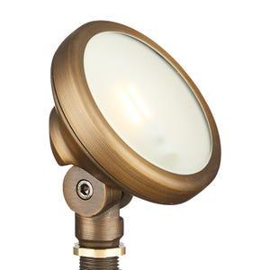 VOLT® brass round wall wash flood light illuminated.