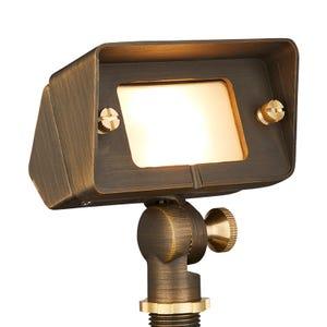 VOLT® Gentle Splash brass flood light and wall wash light illuminated.