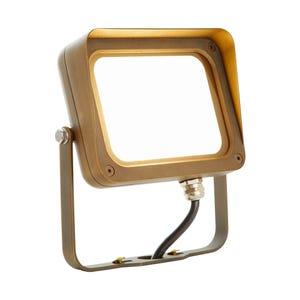 VOLT® 22W integrated brass LED flood light with yoke mount illuminated.