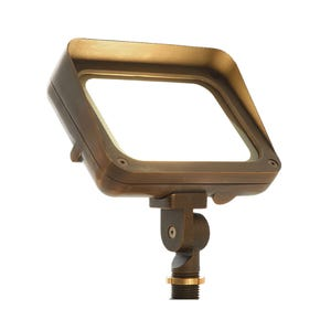 VOLT® 120V 17W LED Brass Flood Light with knuckle mount illuminated.