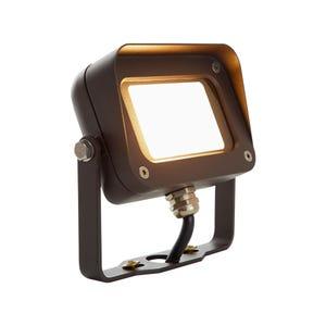 VOLT® 7W integrated brass LED flood light with yoke mount.