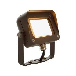 VOLT® 10W integrated brass LED flood light with yoke mount in aluminum bronze.