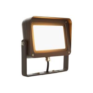 VOLT® 30W integrated brass LED flood light with yoke mount in aluminum bronze illuminated.