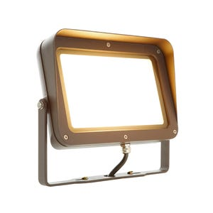 VOLT® 50W integrated brass LED flood light with yoke mount in aluminum bronze illuminated.