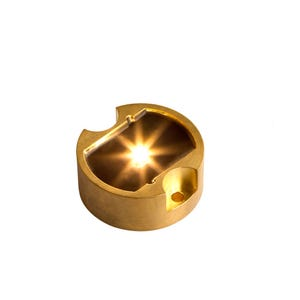 VOLT® BuddyPro brass LED puck light 2700K illuminated.
