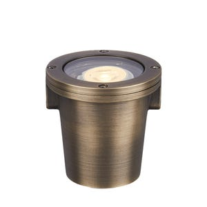 VOLT® Salty Dog MR11 brass in-grade well light illuminated.