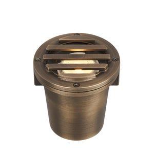 VOLT® Salty Dog MR11 grated brass in-grade well light illuminated.